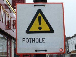 pothole sign 8352434027_6b605fab06
