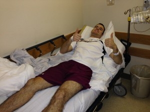 Lucas surgery thumbs up stretcher image