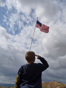 child saluting american flag 2