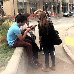 teens together staring at their cell phones 15540378422_90c430cbe6_m